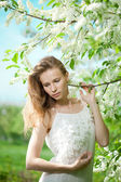 Spring woman blossoming garden — Stock Photo