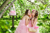 Twins in pink doll style — Stock Photo
