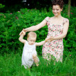Baby with mother in park — Stock Photo #11942038
