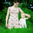 Baby with mother in park — Stock Photo