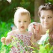 Stock Photo: Baby with mother in park