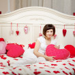 Woman in bed with hearts — Stock Photo