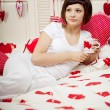 Woman in bed with hearts — Foto de Stock