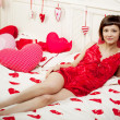 Woman in bed with hearts — Stock Photo #11942317