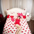 Woman in bed with hearts — 图库照片 #11942325