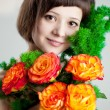 Woman with flowers — Stockfoto