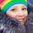 Winter woman in rainbow hat — Stock Photo #11943480