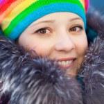 Winter woman in rainbow hat — Stock Photo #11943480