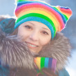 Winter woman in rainbow hat — Stock Photo #11943535