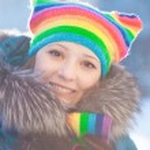 Winter woman in rainbow hat — Stock Photo #11943535