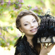 Witch with a strange cage - Stock Photo