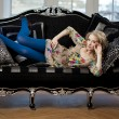 Beauty woman in luxurious sofa — Stock Photo #11944477