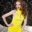 Stock Photo: Luxury woman in a short yellow dress