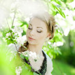 Woman with a hair braid in a blossoming park. — Stock Photo #11945720