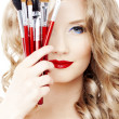 Stylist with make up brushes — ストック写真