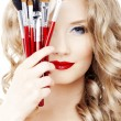 Stock Photo: Stylist with make up brushes