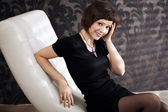 Beautiful woman on the couch — Stock Photo