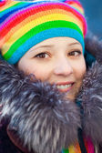 Winter woman in rainbow hat — Stock Photo