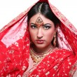 Young woman in indian red sari — Stock Photo