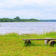 Stock Photo: Bench by lake in Braslav