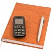 Closed diary with a pen and mobile phone — Stock Photo #11536080