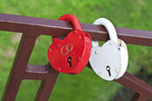 Two locks in the form of hearts — Stock Photo