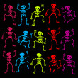 Stock Vector: Colorful Dancing Skeletons