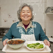 Stock Photo: Cooking grandmother