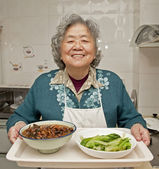 Cooking grandmother — Stock Photo