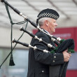 Touring show performance of Scotland Highland musician — Stock Photo