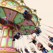 Happy playing chairoplane — Stock Photo