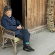 Old man in a old town - Lizenzfreies Foto
