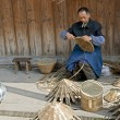 Man and traditional handwork in a chinese little town — Stock Photo
