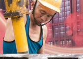 Hardworking laborer on construction site — Stock Photo