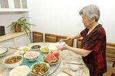 Grandmother is preparing dinner — Stock Photo