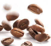 Jumping coffee beans — ストック写真