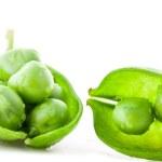 Fresh green pea pod and peas — Stock Photo