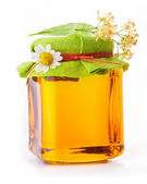Honey in glass jar — Stock Photo