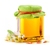Honey in glass jar — Stock Photo