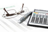 Pen, Calculator and glasses — Stockfoto