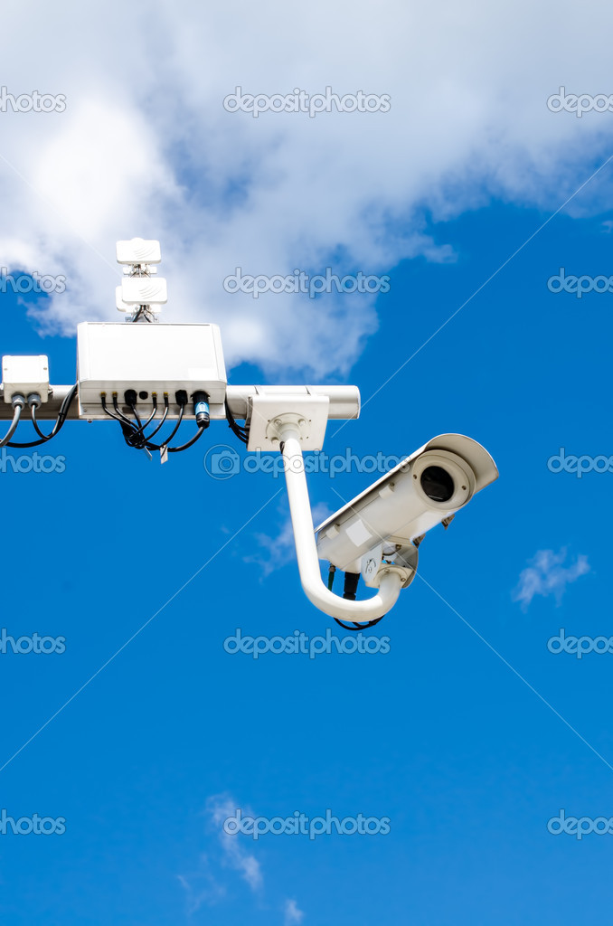 Surveillance camera on blue sky bacgroung — Stock Photo #10978996