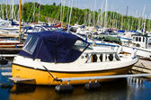 Old yellow boat in the harbor — Stock Photo