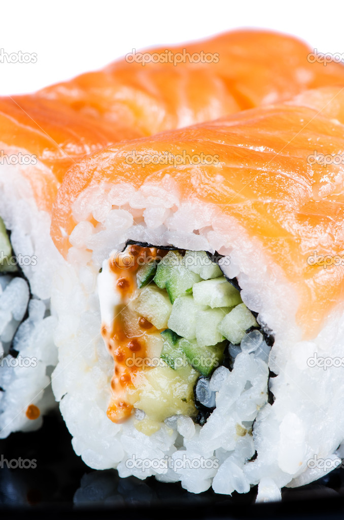 Traditional japanese food roll made of salmon close up — Stock Photo #11023633