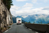 Road with motor home in mountains — Stock Photo