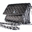Small black quilted bag ladies - Stock Photo