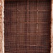old rustic mesh window screen on the wall in venice, italy — Stock Photo