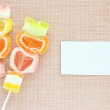 Colorful jelly candy stick and white paper label — Stock Photo #10918330
