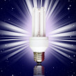 Compact florescent light bulb on night sky background — Stock Photo
