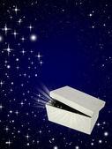 Open magic gift box on night sky background — Stock Photo