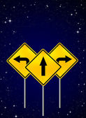 Signs straight, turn left, turn right on night sky — Стоковое фото